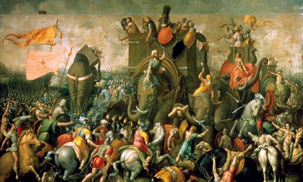 Pintura de Giulio Romano representando as 3 Guerras Púnicas (264 a.C. - 146 a.C.) travadas entre Cartago e Roma pelo domínio do Mar Mediterrâneo. O Exército de Aníbal usava elefantes contra a cavalaria do exército romano de Cipião, o Africano. Fonte: R7.com
